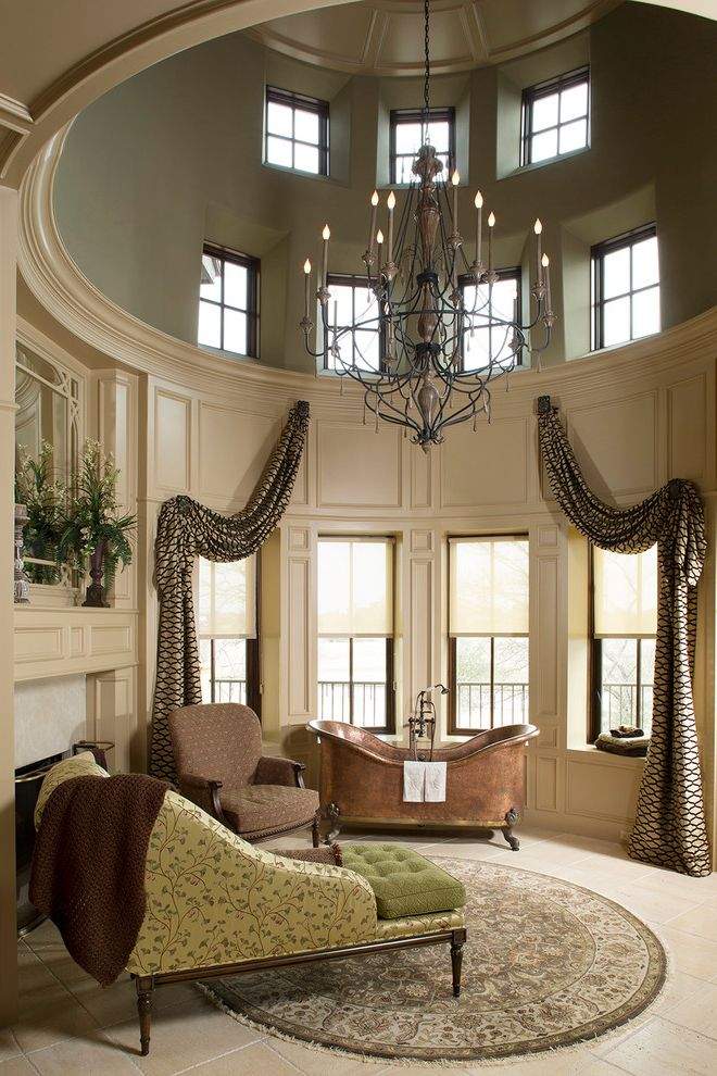 The Woodlands of College Station with Traditional Bathroom  and Beige Floor Tile Beige Wall Paneling Chandelier Curved Walls Fireplace High Ceiling Indoor Chaise Lounge Round Area Rug Round Room