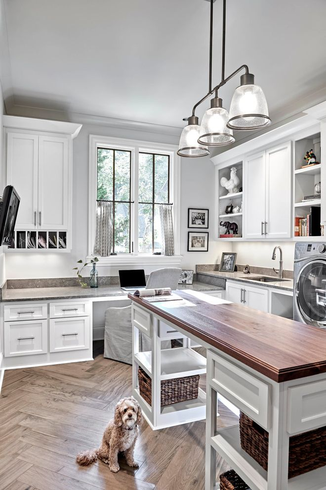 The Woodlands of College Station with Transitional Laundry Room  and 3 Light Hanging Fixture Bright Built in Desk Herringbone Wood Floor Island in Laundry Room Lots of Counter Space Wicker Baskets Window Over Desk