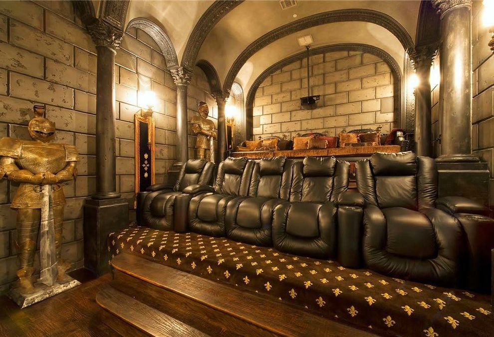 Theater Conroe Tx with Mediterranean Home Theater and Armor Barrel Vault Ceiling Black Chairs Carpet Corinthian Columns Dark Wood Flooring Dark Wood Stairs Fleur De Lis Ornate Palatial Stone Walls