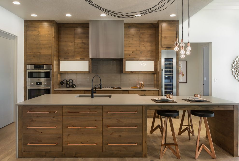 Theaters in Boise Idaho   Contemporary Kitchen  and Backless Barstools Black Wineholder Copper Accents Gray Countertops Hanging Lightbulbs Recessed Lighting Stainless Steel Stove