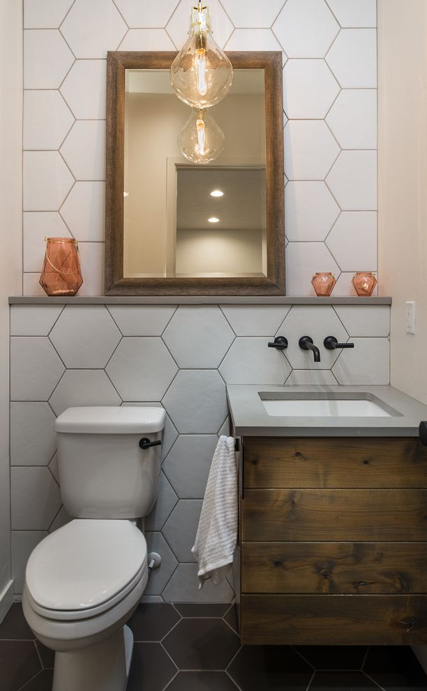 Theaters in Boise Idaho with Transitional Powder Room  and Floating Vanity Glass Pendant Light Gray Countertop Hexagon Tile Wall Mounted Faucet