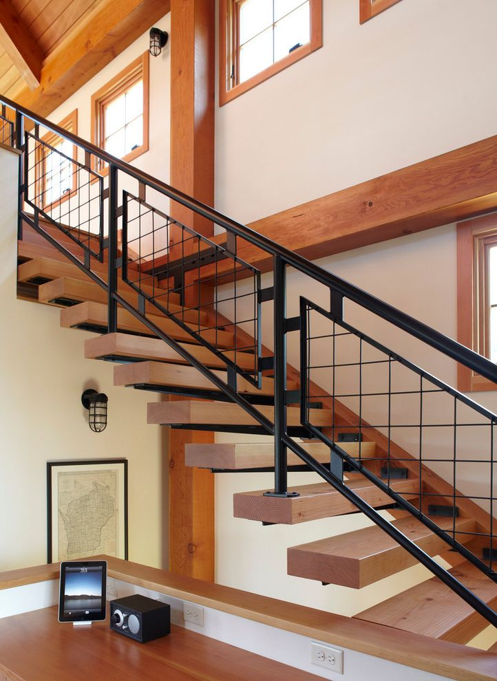 Thick Stair Treads with Farmhouse Staircase  and Decorative Railing Exposed Beams Farm House Floating Staircase Industrial Sconce Metal Railing Modern Barn Open Risers Steel Staircase Sustainable Under Stairs Storage Wood Staircase