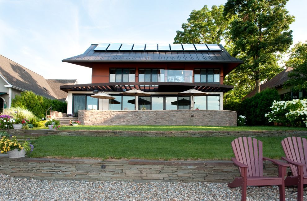 Thigpen Heating and Air with Contemporary Exterior  and Adirondack Chair Backyard Gravel Metal Ceiling Overhang Pergola Solar Panels Standing Seam Roof Stone Wall Terrace Umbrella