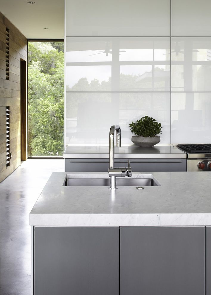 Thrift Drain Cleaner with Contemporary Kitchen Also Concrete Floor Floor to Ceiling Windows Gray Cabinets Grey Cabinets Kitchen Island Kitchen Island Sink Potted Plant White Countertop White High Gloss Wall Wolf Stove Wood Wall