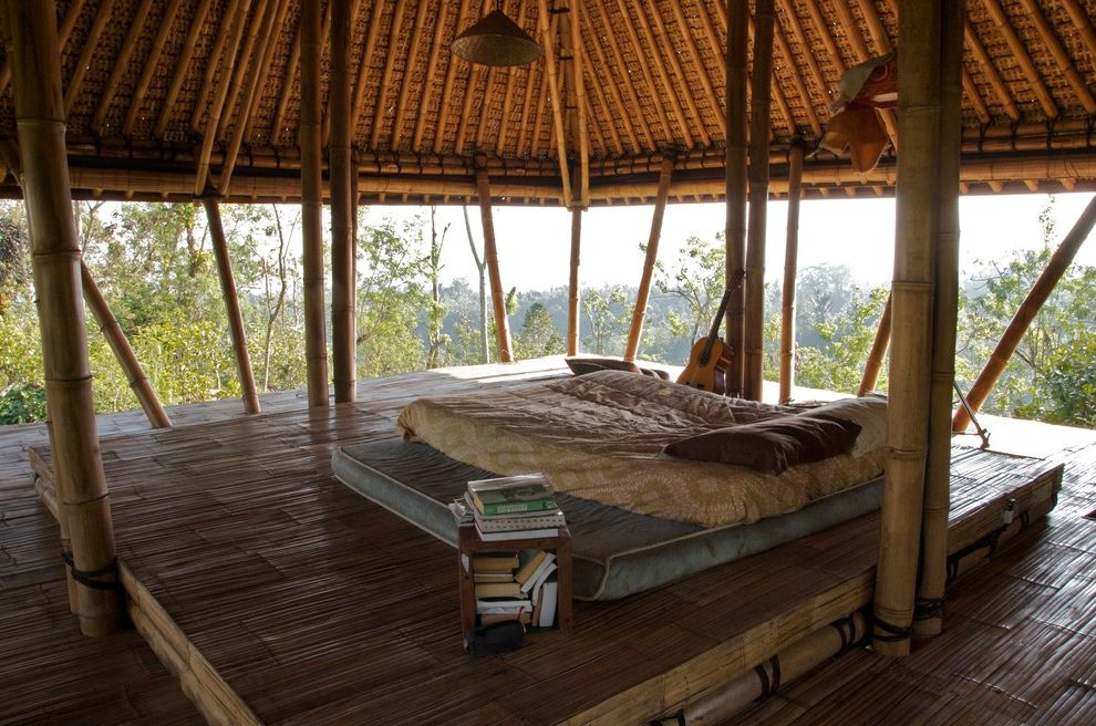 Tidewater Property Management   Tropical Bedroom  and Bamboo Beam Bamboo Ceiling Bamboo Deck Bamboo Post Bamboo Shingles Cane Deck Platform Guitar Open Air Living Open Room Platform Deck Raised Platform Bed Room with a View Treehouse Wood Nightstand