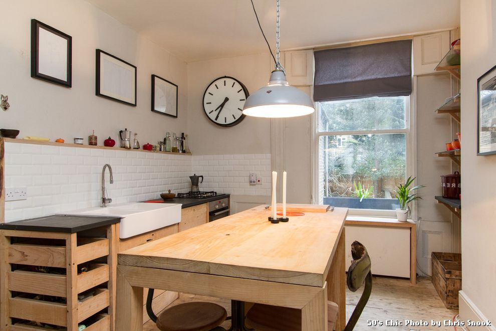 Tile and Wood Floor Combination with Midcentury Kitchen and Ceiling Light Farmhouse Sink Open Shelves Roman Blind Rustic Wood Floor Subway Tile Tiled Backsplash White Ceiling Light White Tile Wood Floor Wood Table