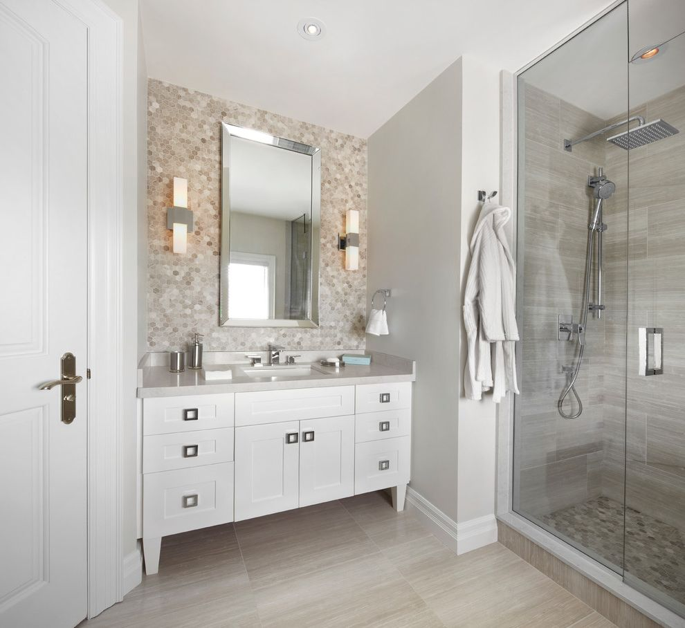 Tile Market of Delaware   Transitional Bathroom  and Accent Wall Framed Rectangular Mirror Frameless Shower Glass Gray Countertop Gray Floor Tile Handshower Hex Tile Rainshower Head Recessed Lighting Sloped Ceiling Tapered Legs Wall Sconces
