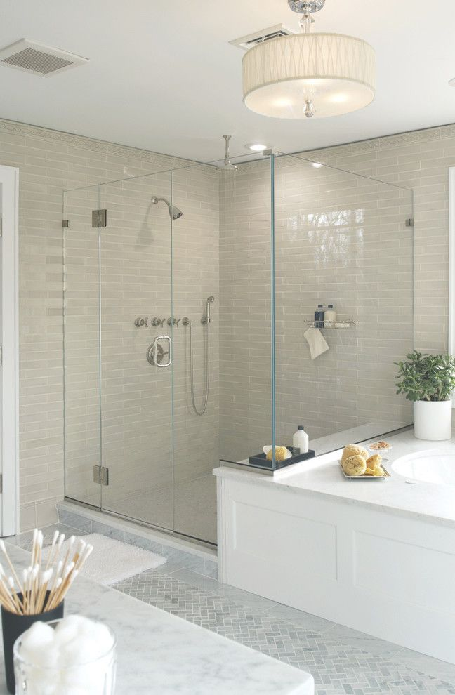 Tile Outlets of America   Transitional Bathroom  and Bright Clear Shower Glass Drum Ceiling Light Glass Herringbone Luxe Marble Tile Modern Shower Tan Tile Wall Tile Rug Wood Tub Surround
