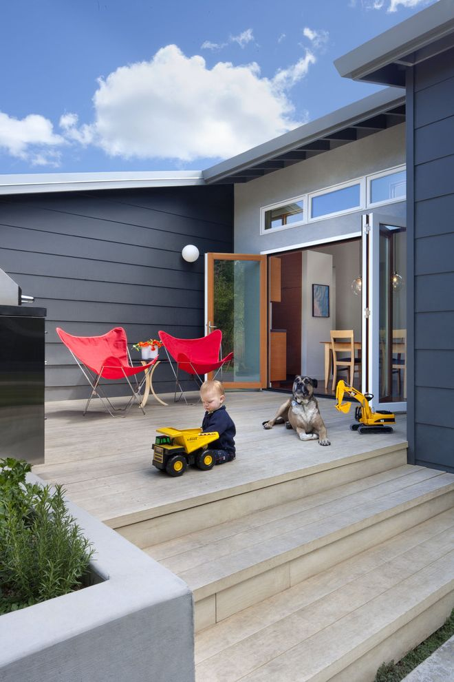 Timbertech Decking Colors with Modern Deck  and Concrete Planter Dark Gray Exterior Dark Grey Exterior Dog Folding Glass Doors Glass Door Globe Light Grill Indooroutdoor Living Kids Toys Light Wood Patio Light Wood Stairs Red Butterfly Chair