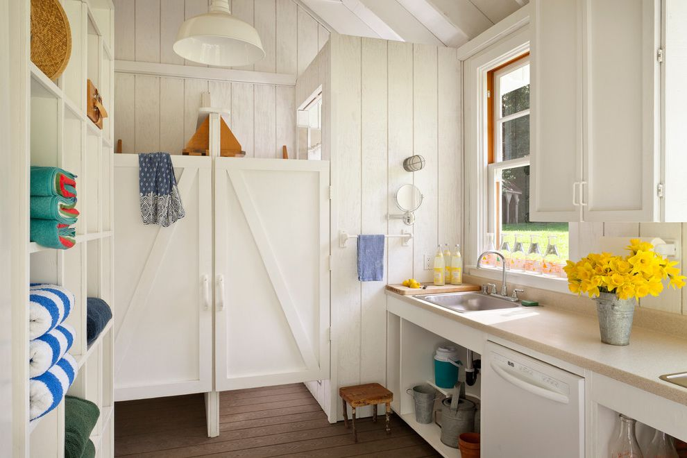 Tiny Shower Stall with Farmhouse Kitchen Also Barn Lamp Daffodils Deck Farm Farmhouse Kitchenette Linen Storage Rustic Wood Towel Storage Vaulted Ceilings White Painted Wood Wood Paneling