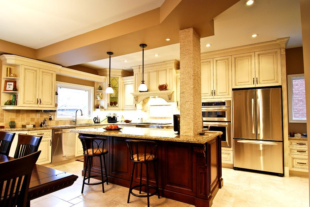 Tlc Plumbing Albuquerque with Traditional Kitchen  and Barstools Beige Black Accents Blue Dark Wood Dining Area Granite Island Painted Cabinets Pendant Lights Stainless Steel Appliances Tan Tile Floors Wall Oven