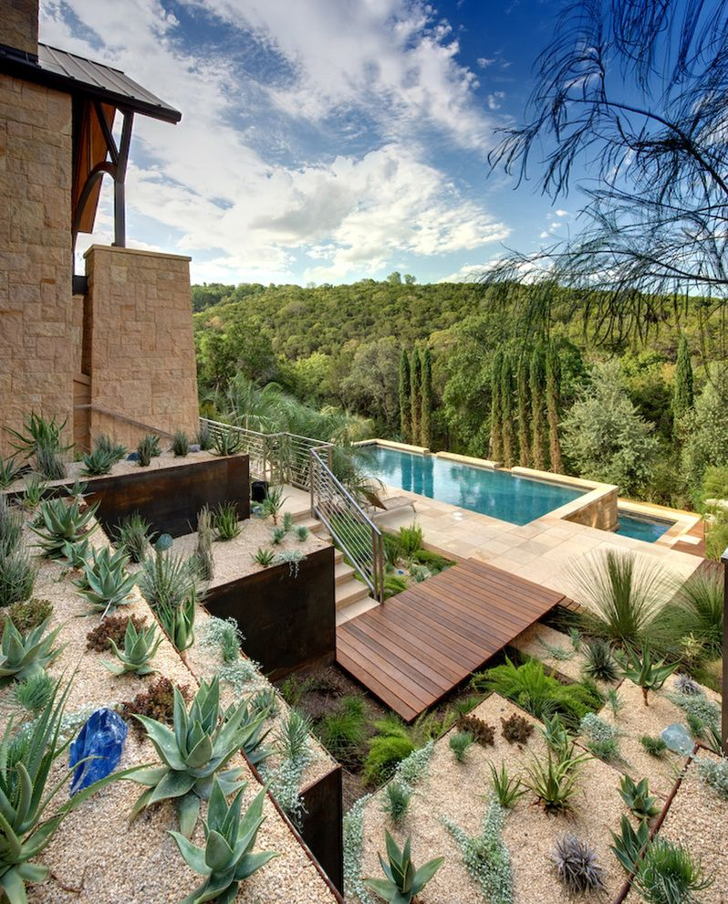 Toscana of Desert Ridge   Southwestern Landscape  and Deck Desert Modern Ipe Deck Low Water Metal Minimal Planters Pool Retaining Walls Rust Steel Retaining Walls Succulents Terrace View