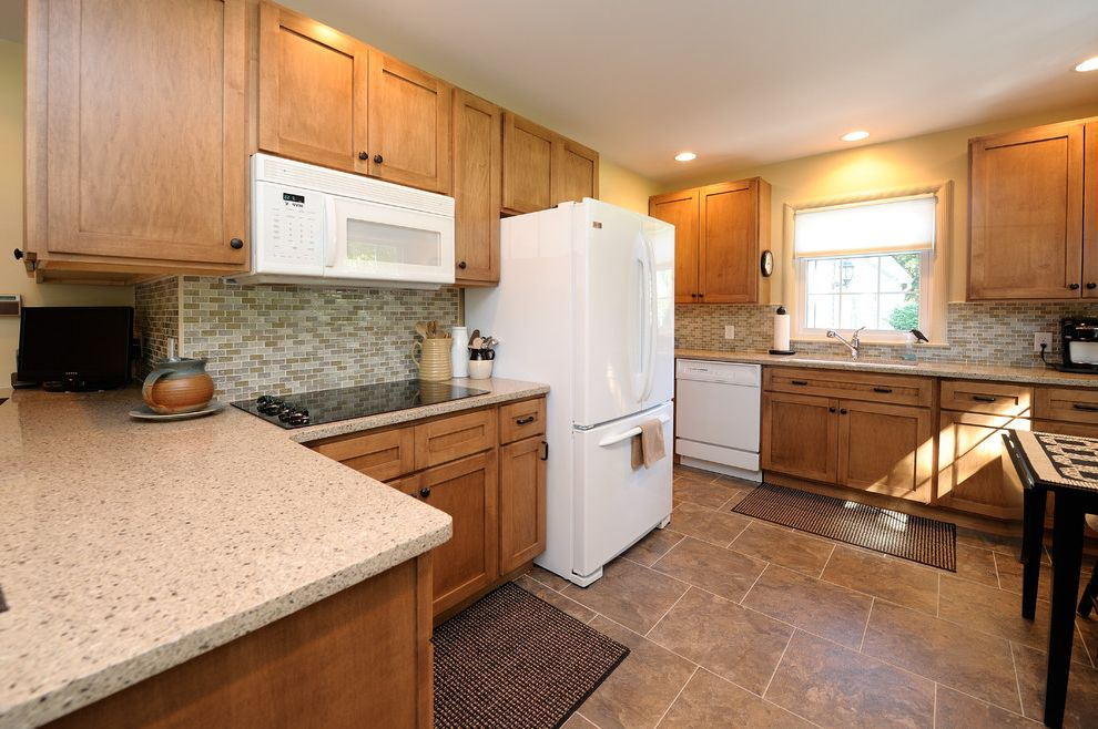 Town and Country Appliance   Traditional Kitchen Also Beige Walls Cooktop Microwave Recessed Lighting Recessed Panel Cabinets Small Table Tile Backsplash Tile Floor White Appliances Window Over Sink