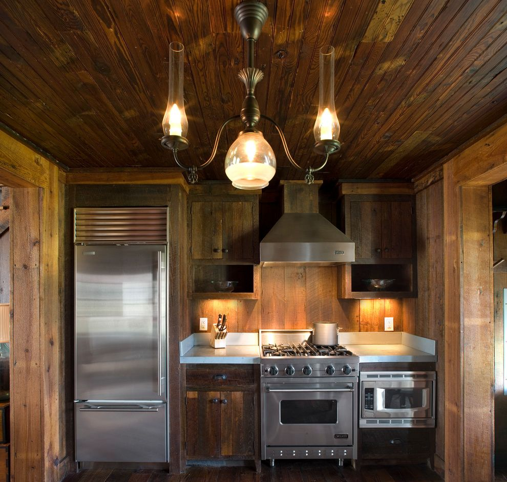 Town and Country Appliance with Farmhouse Kitchen  and Beadboard Chandelier Hood Knotty Pine Open Shelves Pine Rustic Rustic Wood Small Appliances Small Kitchen Stainless Appliances Viking Range Vintage Lighting Wood Floors Wood Walls
