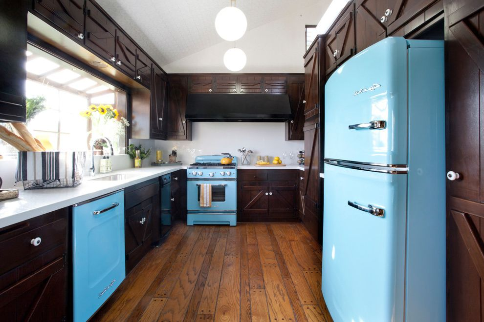 Town and Country Appliance with Rustic Kitchen  and Blue Appliances Dark Brown Cabinets Galley Kitchen Globe Pendant Hardwood Floor Ledge Sink Sloped Ceiling White Backsplash White Countertop Window