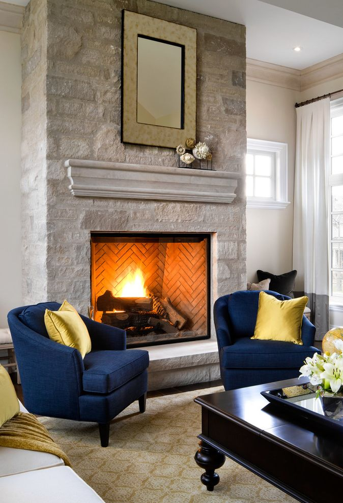 Town and Country Fireplaces   Traditional Living Room  and Gas Fireplace Jane by Jane Lockhart Jane Lockhart Navy Chairs Statum Designs Stephanie Chair Stone Mantel