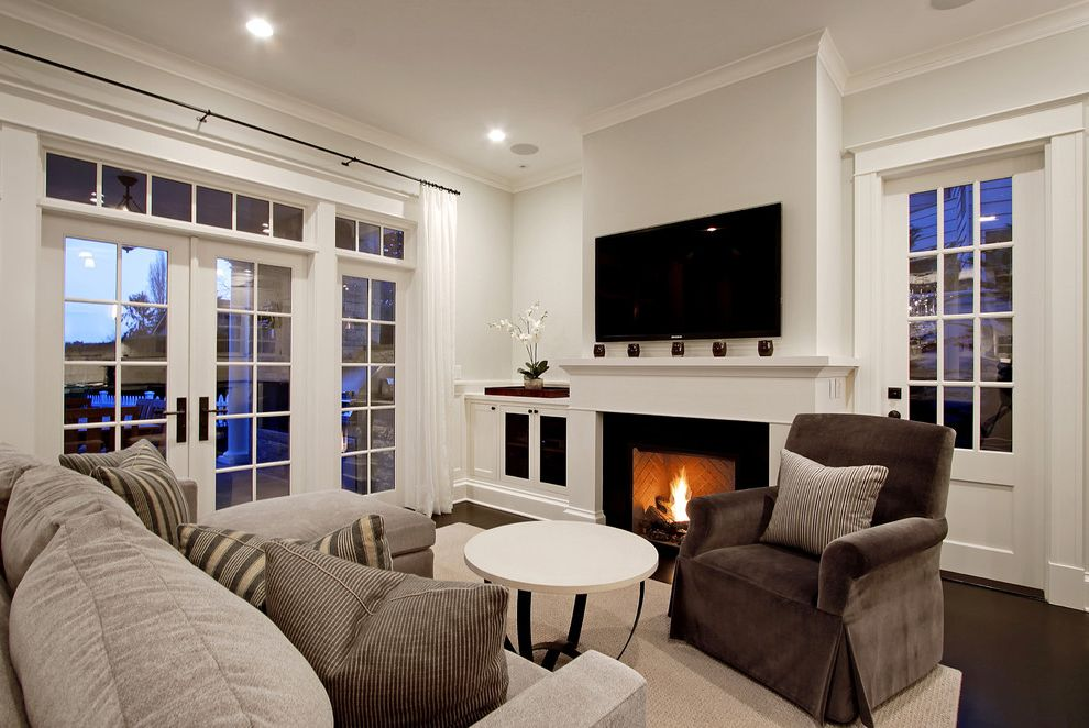 Town and Country Fireplaces with Traditional Family Room Also Area Rug Arm Chair Crown Molding Fireplace French Doors Pillows Sofa Transom Windows Tv White White Round Coffee Table Wood Floor