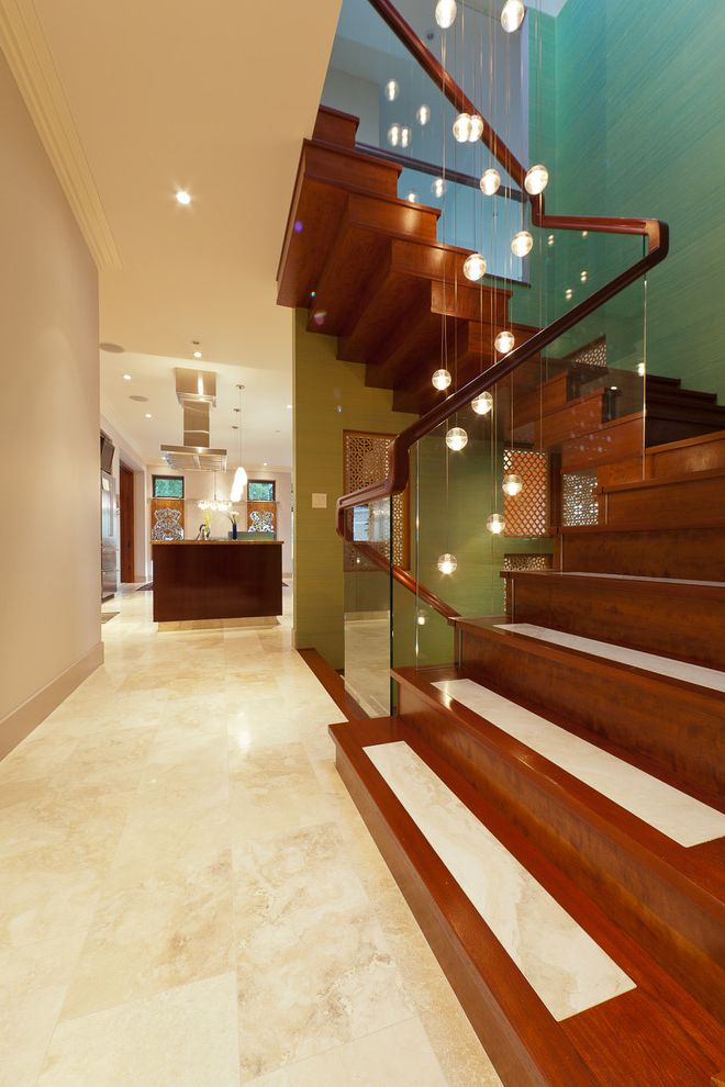 Travertine Tile Pros and Cons   Contemporary Staircase Also Beige Walls Dark Stained Wood Glass Panel Green Kitchen Pendant Lights Recessed Lights Tile Floor Tile Inlay Travertine Wood Railing