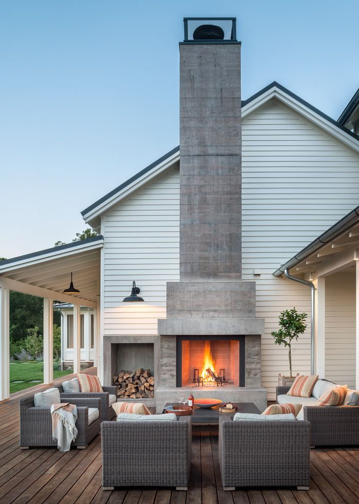Travis Industries House of Fire   Farmhouse Deck  and Contemporary Farm House Logs Modern Farm House Napa Valley Outdoor Living Outdoor Pillows Outdoor Sconces Porch White Farm House Wicker Chairs Wine Country