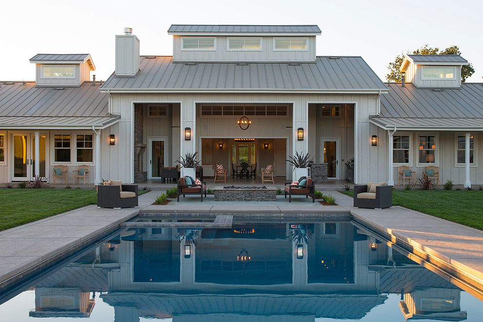 Travis Industries House of Fire   Farmhouse Patio  and Bonnet Roof Clerestory Windows Cupola Fire Pit Indoor Outdoor Living Main House Pool Square Columns Standing Seam Metal Roof