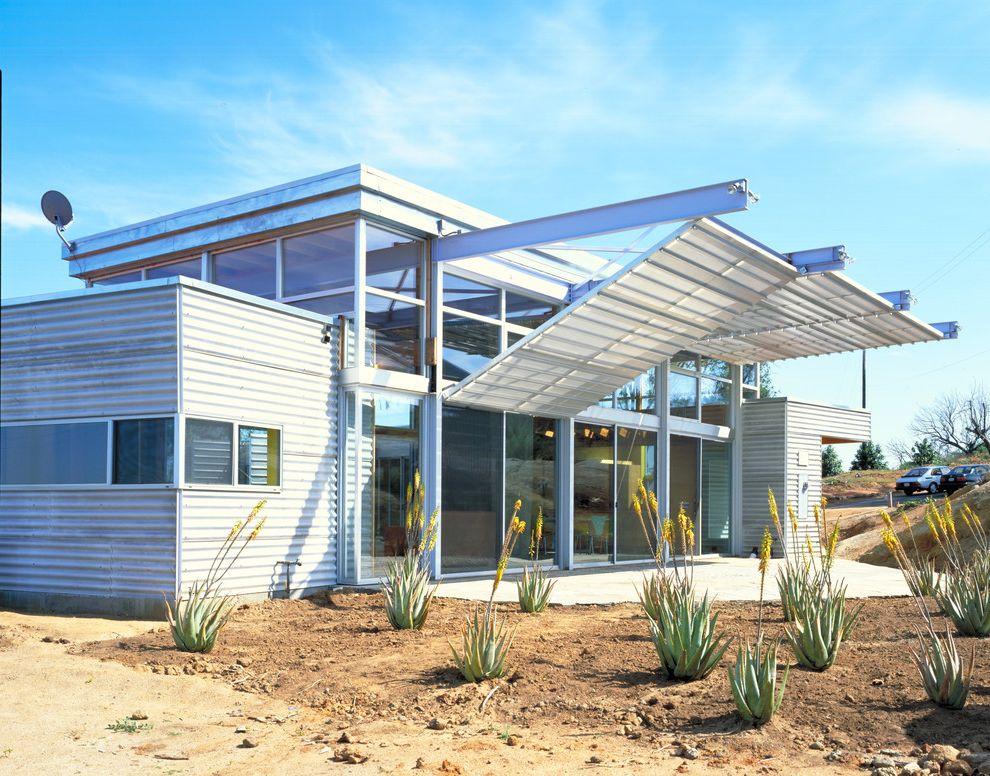 Travis Industries House of Fire   Industrial Exterior Also Desert Landscape Flat Roof Landscape Large Window Metal Overhang Patio Sliding Patio Door Steel Sunshade