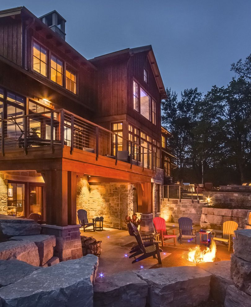 Travis Industries House of Fire   Rustic Patio Also Adirondack Chairs Balcony Boulders Cable Rail Cedar Covered Porch Deck Fire Fire Pit Metal Roof Modern Outdoor Entertaining Patio Rustic Stone Terrace