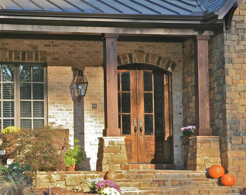 Trex Decking Colors   Traditional Entry Also Brick House Brick Wall Double Doors Entrance Entry Front Doors Gas Light Lanterns Lintel Metal Roof Old World Outdoor Lighting Porch Pumpkins Raleigh Scott Daves Standing Seam Roof Stone Steps