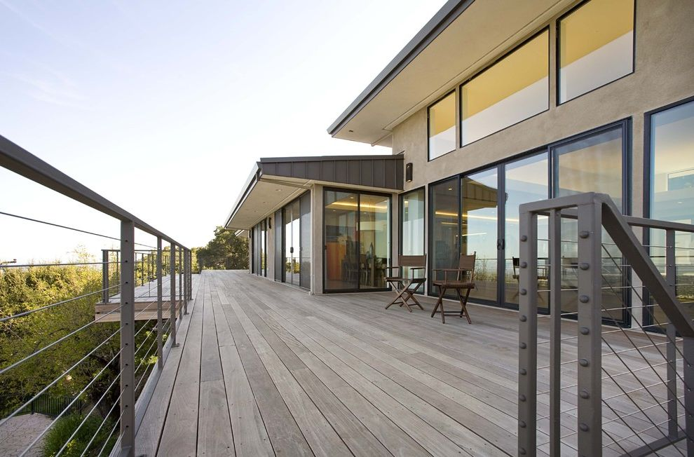 Trex Decking Colors with Contemporary Deck  and Balcony Cantilever Ceiling Lighting Deck Directors Chairs Glass Doors Overhang Patio Furniture Recessed Lighting Sliding Doors Steel Cable Railing View Wood Flooring