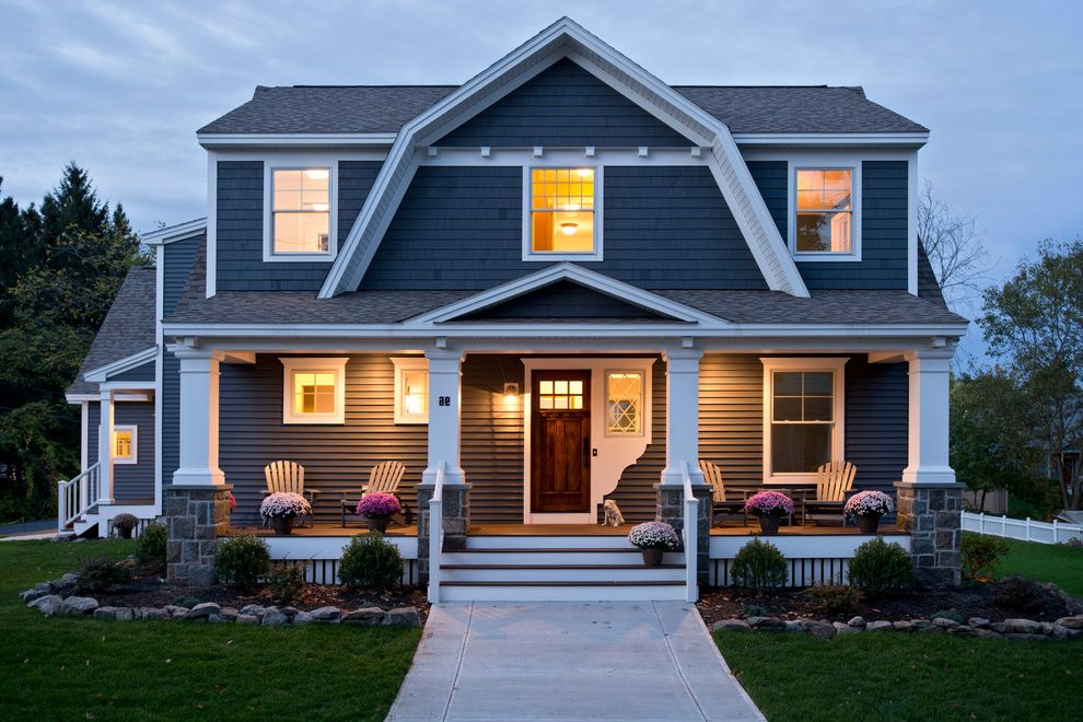 Trex Decking Colors with Traditional Exterior Also Adirondack Chairs Blue Siding Entry Front Door Front Porch Grass Lawn Night Lighting Pediment Plants Shingle Roof Shingle Siding Two Story Walkway White Columns White Trim Wood Door