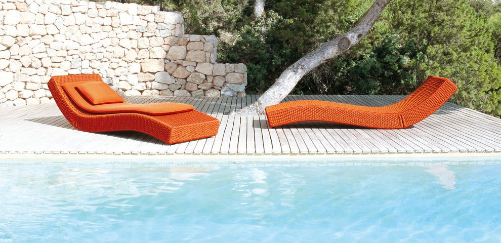 Tropitone Lounge Chairs   Contemporary Pool  and Chaise Lounge Deck Minimal Orange Outdoor Cushions Patio Patio Furniture Pool Deck Stacked Stone Stone Retaining Wall Stone Wall Wood Flooring