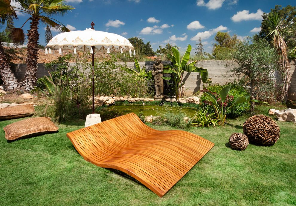 Tropitone Lounge Chairs with Eclectic Landscape Also Banana Trees Chaise Lounge Floor Cushions Garden Art Grass Lawn Palm Trees Patio Furniture Patio Umbrella Pond Sculptures Statues Turf Water Feature