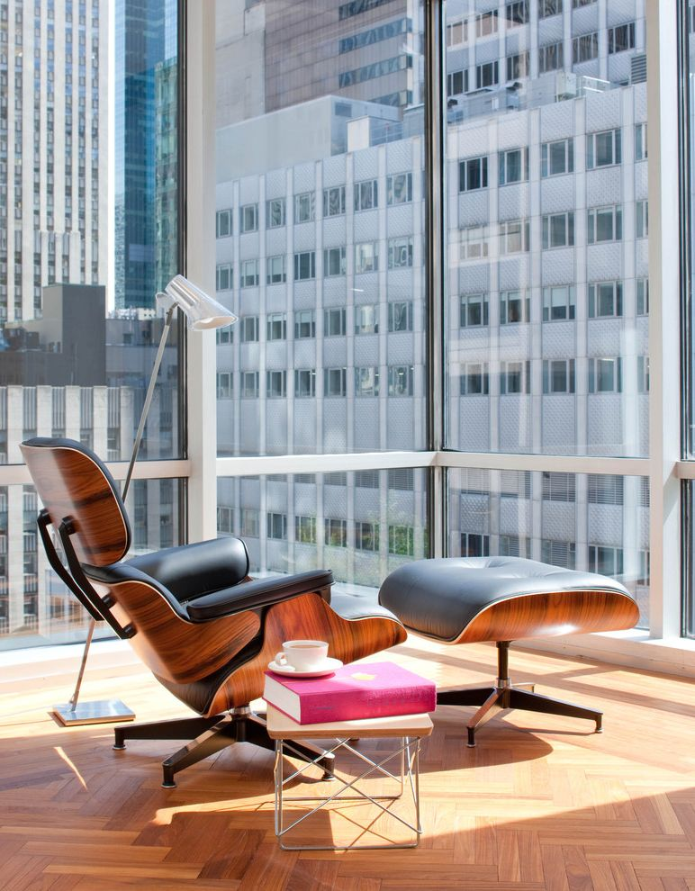Tropitone Lounge Chairs with Midcentury Spaces Also Bright City Corner Windows End Table Floor Lamp Glass Leather Armchair Lounge Chair Manhattan Mid Century Modern Ottoman Parquet Floors Side Table Urban View Windows Wood Wood Flooring
