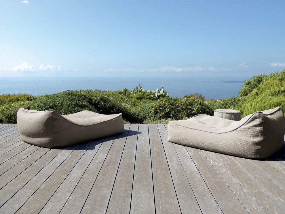 Tropitone Lounge Chairs with Rustic Deck  and Bean Bag Chairs Chaise Lounge Coastal Deck Minimal Neutral Colors Outdoor Cushions Patio Furniture Rustic View Waterfront Wood Flooring