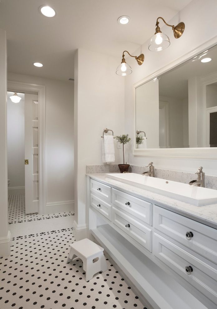 Trough Sinks with Two Faucets   Traditional Bathroom Also Footstool Framed Mirror Jack and Jill Sink Marble Counter Pocket Door Recessed Lighting Tile Floor Trough Sinnk Two Faucets Vanity White Walls