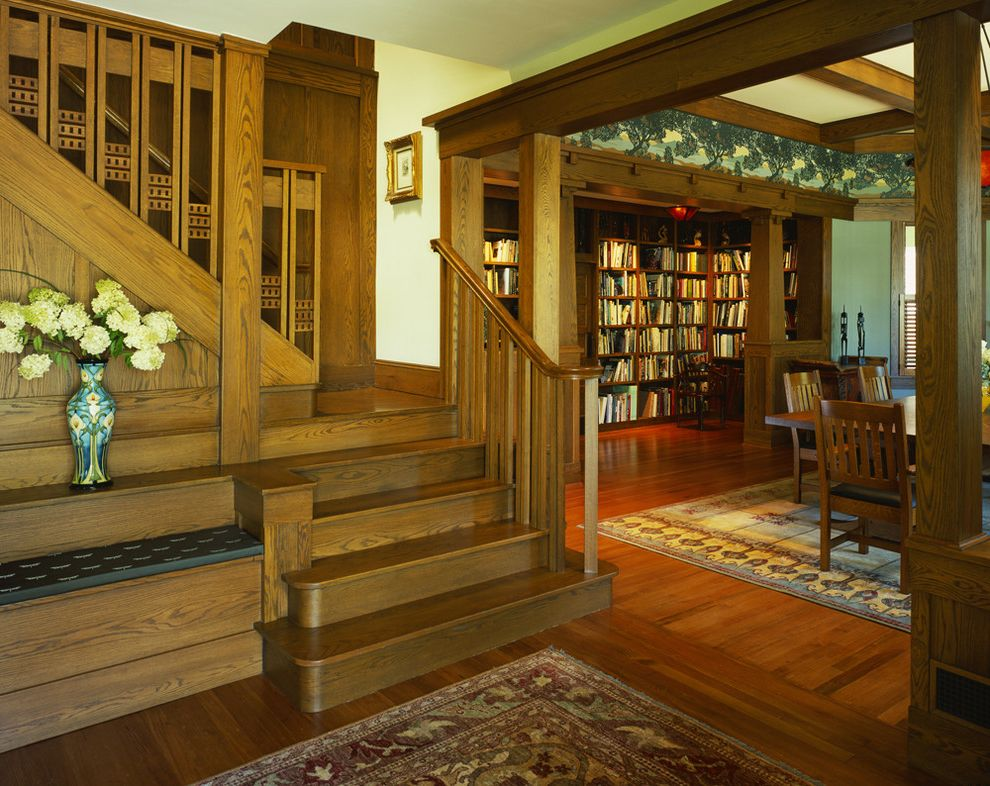Tudor Definition   Craftsman Staircase  and Accent Wood Trim Blue Wall Bookcase Bookshelves Built in Bench Coffered Ceiling Diningroom Library Oriental Carpet Parquet Floor Rustic Stairs Tudor Staircase Vase Wood Wood Stairs