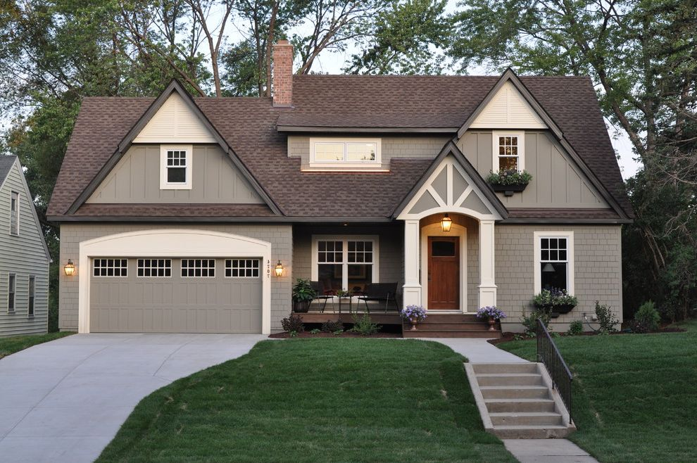 Tudor Definition   Traditional Exterior  and Board and Batten Driveway Entrance Entry Front Porch Garage Doors Grass Lanterns Lawn Outdoor Stairs Shingle Siding Turf Window Boxes Wood Siding