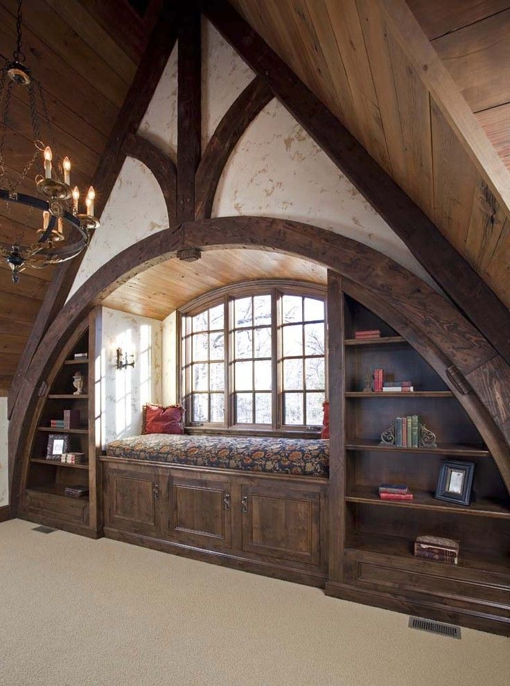 Tudor Definition with Traditional Home Office Also Arch Bookcase Built Ins Carpet Chandelier Dark Tone Wood Exposed Beams Open Shelving Red Cushions Slanted Ceiling Storage Bench Upholstery Window Seat Wood Ceiling