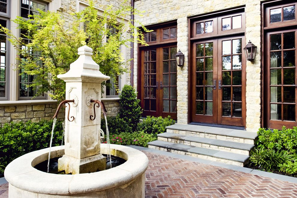 Tudor Definition with Traditional Patio Also Brick Paving Courtyard Fountain French Doors Garden Wall Herringbone Pater Lanterns Outdoor Lighting Patio Planters Stone House Tudor Water Feature