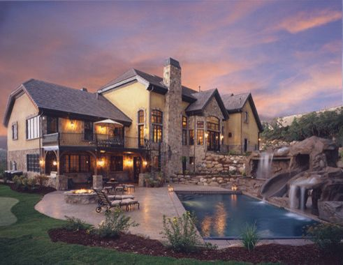 Tuscany Utah with Traditional Exterior Also Back Yard Balcony Bay Window Brown Shingles Chimney Covered Patio Eruopean Pool Rock Rock Chimney Stained Concrete Stamped Concrete Stucco Tan Stucco Tuscany Water Feature Water Slide
