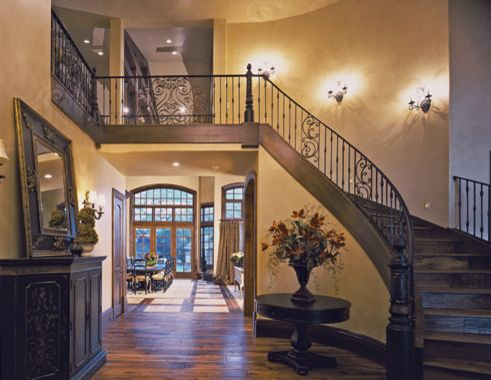 Tuscany Utah with Traditional Staircase Also Arched Staircase Balcony Entry Eruopean Front Entry Hallway Metal Railing Tan Walls Tuscany Valted Ceiling Walk Way Wood Floor Wood Stairs