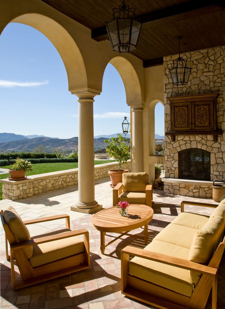 Tv Covers for Outdoors with Mediterranean Patio Also Arches Archway Columns Covered Patio Exposed Beams Lanterns Loggia Outdoor Cushions Outdoor Fireplace Outdoor Living Patio Furniture Terra Cotta Tile Wood Ceiling