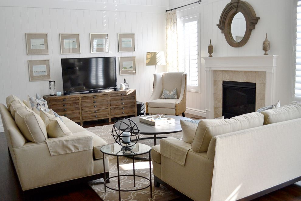 Tv Stand Decoration Ideas with Traditional Family Room  and Area Rug Coffee Table Fireplace Neutral Rooms Sofa Wall Art White Paneling White Room White Walls Wood Floor Wood Walls Wood Work