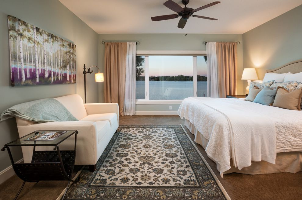 Tv Viewing Distance   Traditional Bedroom  and Beige Curtains Blue Throw Brown Carpet Floral Rug Light Blue Walls Low Pile Carpet Muted Colors Sheer Window Treatment White Bedding White Sofa White Window Trim