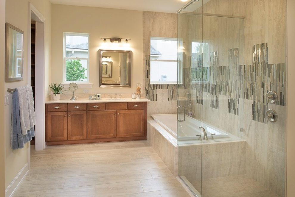 Twenty Mile Theater   Transitional Bathroom  and 1 Mirror 1 Sink Bath Tub Bathtub Glass Shower Grey White Tile Bathroom Master Bath Master Bathroom Tile Floors Wooden Cabinets