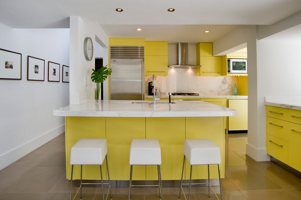 Under Cabinet Lighting with Outlets with Midcentury Kitchen  and Bright Kitchen Bright Yellow Wall Art Wall Clock White Counter Stools Yellow Kitchen