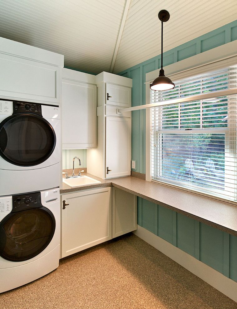 Under Counter Hot Water Heater   Rustic Laundry Room  and Aqua Beadboard Blinds Board and Batten Cabinet Counter Dryer Front Loading Washer Pedant Light Railing Sink Stackable Washer and Dryer Stacked Washer and Dryer Terrazzo Turquoise