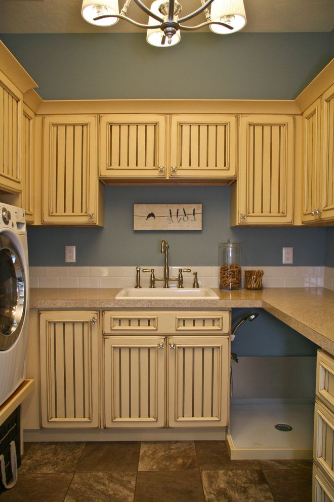 Under Counter Hot Water Heater with Traditional Laundry Room  and Artwork Beadboard Chandelier Frame and Panel Cabinets Gray Walls Sink Tile Backsplash Tile Floor