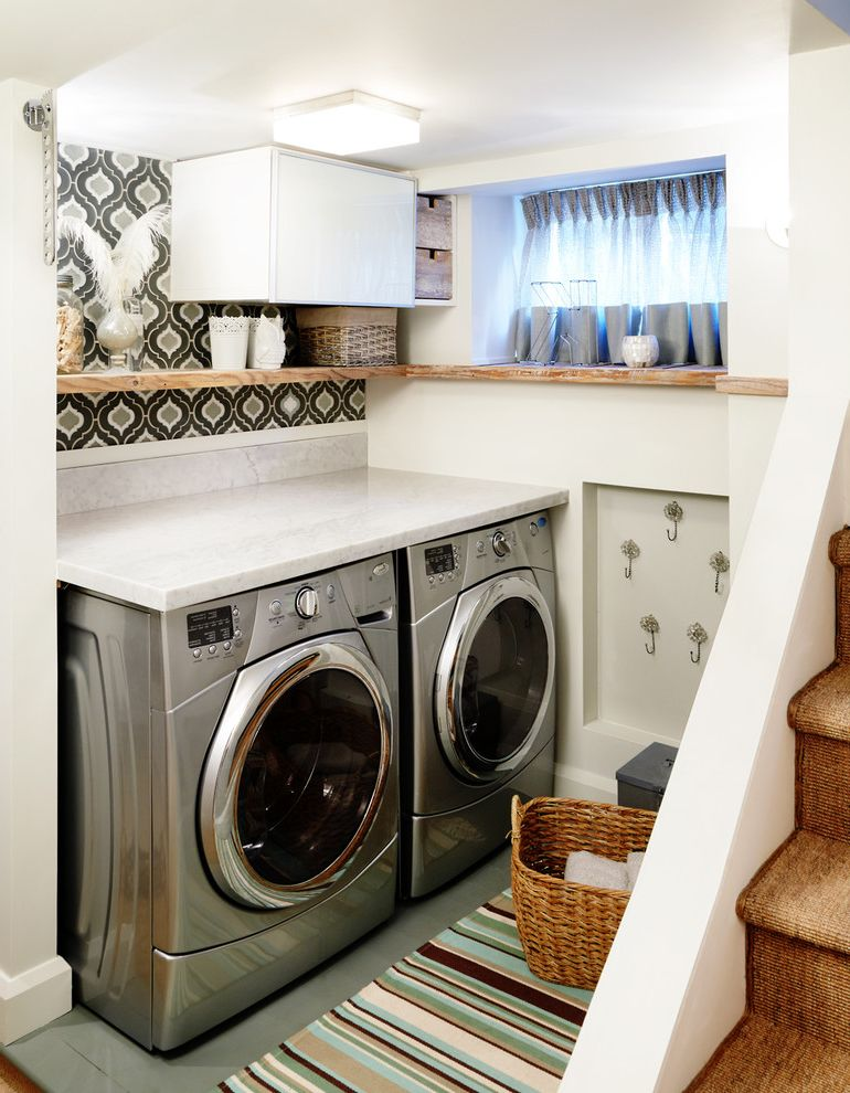 Under Counter Washer and Dryer   Contemporary Laundry Room Also Basket Counter Over Appliances Front Loading Glass Tile Hidden Storage Laundry Room Marble Counter Moroccan Wallpaper Onion Pretty Accents Recalimed Wood Shelves Staircase Striped Rug
