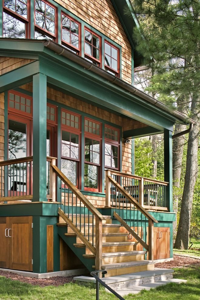 Under Deck Gutter System with Rustic Porch  and Cabin Entrance Entry Entry Stairs Green Trim Red Trim Rustic Shingle Siding Small House Sustainability Wood and Metal Railing