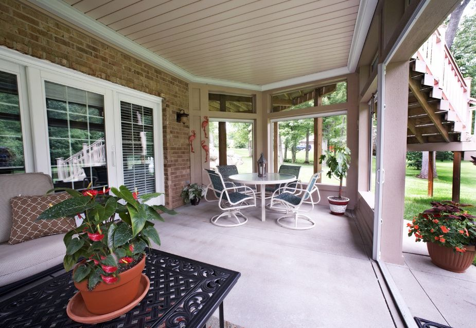 Under Deck Gutter System with Traditional Patio  and Outdoor Space Screened in Porch